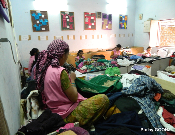 In GOONJ's processing centre, cloth sorting according to the size, gender etc