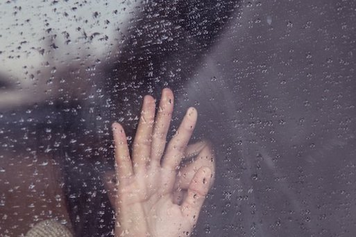 woman crying in rain